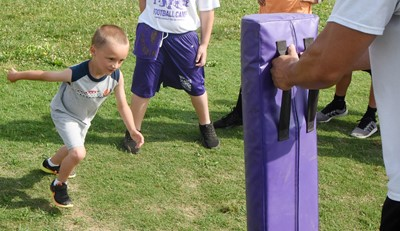 Campbellsville Elementary School first-grader Carter Ward tackles.