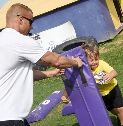 Campbellsville Elementary School kindergartener Bentley Cox tackles.