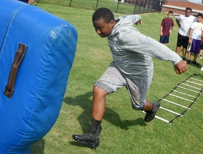 Campbellsville Middle School sixth-grader KeKe Miller runs a drill.