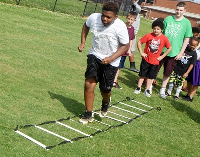 Campbellsville Elementary School fifth-grader Austin Sloan runs a drill.