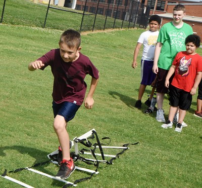Campbellsville Elementary School fifth-grader Brayson Cox runs a drill.