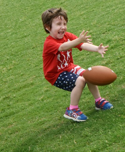 Campbellsville Elementary School kindergartener Noelan McMahan tries to catch the ball.