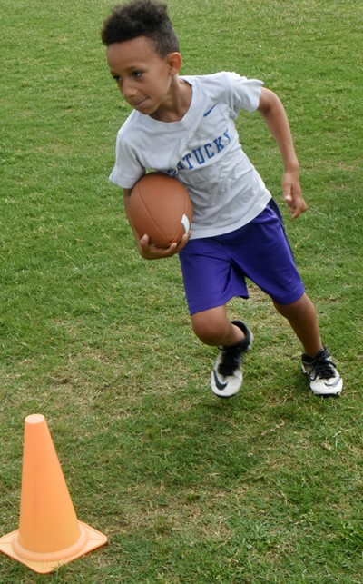 Campbellsville Elementary School first-grader Jaxon Williams runs the ball.
