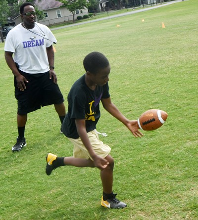 Campbellsville Elementary School fifth-grader John Gholston catches the ball.