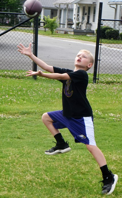 Campbellsville Elementary School first-grader Jackson Wright catches the ball.