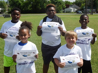 Winners of the throwing competition are, from left, front, Elyzabeth Fisher and Bentley Cox. Back, Julian Smith, Austin Sloan and Zyhaven Taylor.