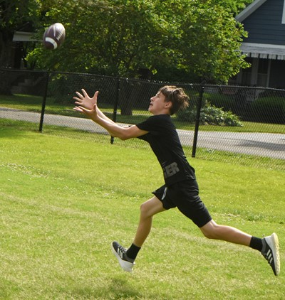 Campbellsville Middle School seventh-grader Jaxon Sidebottom runs for the ball.