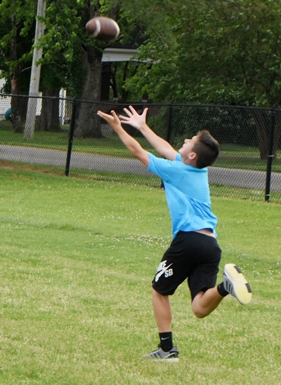Campbellsville Middle School seventh-grader Katon Cox catches the ball.