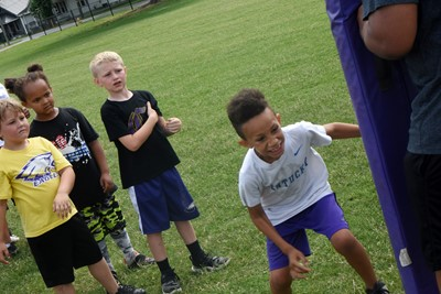 Campbellsville Elementary School first-grader Jaxon Williams tackles.