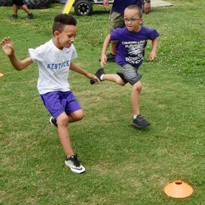 Campbellsville Elementary School first-grader Hayden Goff kicks the ball.