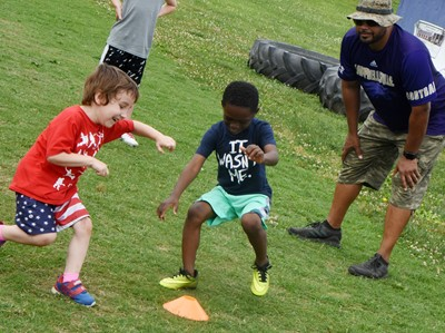 Campbellsville Elementary School kindergartener Noelan McMahan, at left, and preschool student Acen Alexander compete in a running drill.