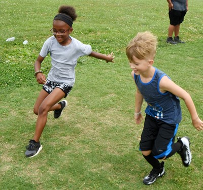 Campbellsville Elementary School third-grader Willow Griffin, at left, and kindergartener Andrew Stout compete in a running drill.