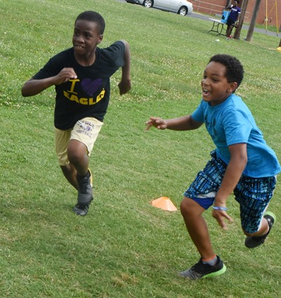 Campbellsville Elementary School fifth-graders John Gholston, at left, and Jalen Embry compete in a running drill.