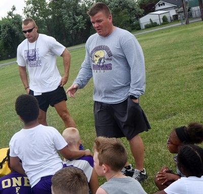 CHS football head coach Dale Estes talks to campers.