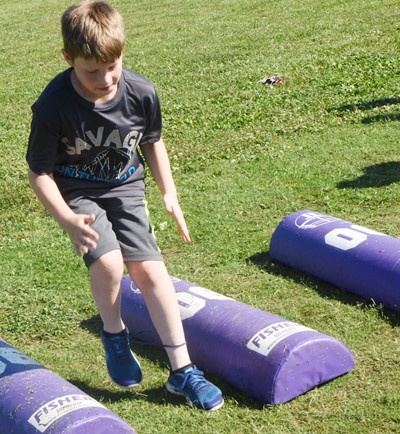Campbellsville Elementary School third-grader Body Sidebottom runs.