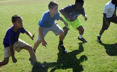 From left, Campbellsville Elementary School fourth-grader Maddox Hawkins, Campbellsville Middle School sixth-grader Katon Cox and fourth-grader Julian Smith practice their offensive stance.