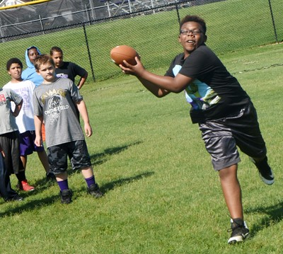 Campbellsville Elementary School fifth-grader Austin Sloan catches the ball.
