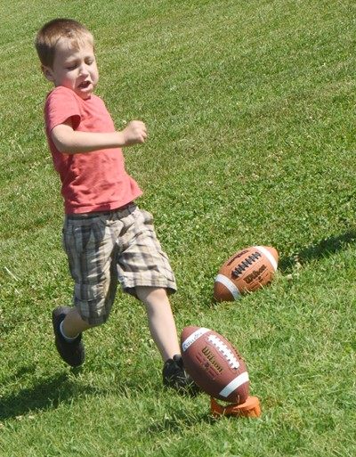 Campbellsville Elementary School kindergartener Dehren Rinesmith kicks the ball.