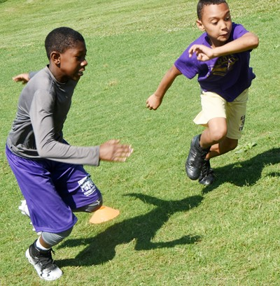 Campbellsville Elementary School fourth-graders Jaron Johnson, at left, and Maddox Hawkins compete in a running drill.