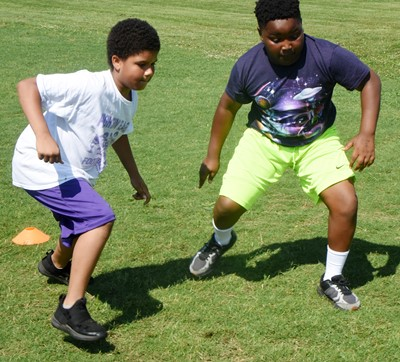 Campbellsville Elementary School third-grader Navon Copeland, at left, and Julian Smith compete in a running drill.