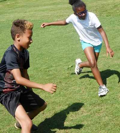 Campbellsville Elementary School fourth-grader Rajon Taylor, at left, and third-grader Willow Griffin compete in a running drill.