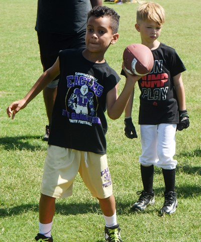 Campbellsville Elementary School first-grader Kingston Cowherd throws the ball.