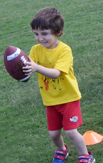 Campbellsville Elementary School kindergartener Noelan McMahan throws the ball.