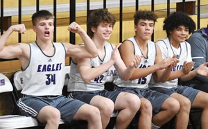 From left, CHS freshmen Konner Forbis and Weston Mattingly, sophomore Logan Phillips and junior Alex Lofton cheer after a basket.
