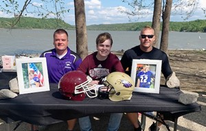 Campbellsville High School senior Tyler Gribbins will continue his academic and football career this fall at Campbellsville University. He was honored in a special ceremony recently with family and friends. Gribbins, center, is pictured with CHS football head coach Dale Estes, at left, and his father Robbie Gribbins, who is an assistant football coach at CHS and CU.