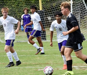 From left, CHS freshman Andrew Butler and juniors Jeffrey Sustaita and Raj Patel watch the ball.