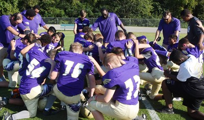 CMS football players pray together before their game.