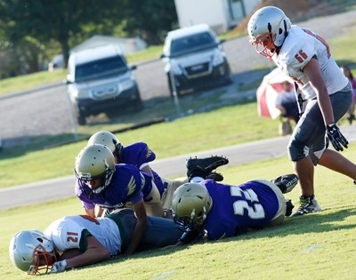 CMS football players tackle.