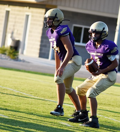 CMS eighth-grader Dalton Morris gets ready to tackle as seventh-grader Katon Cox looks to pass.