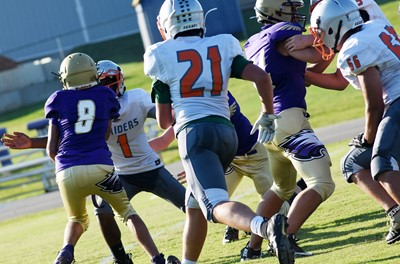 CMS eighth-graders Kaden Bloyd, at left, and Dalton Morris tackle.
