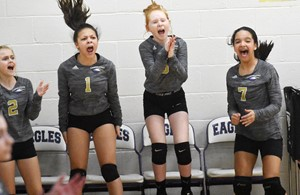 CMS volleyball players, from left, sixth-graders Kennedy Griffiths, Breona Bridgewater, Nora Harris and Aleecia Knezevic cheer on the bench.