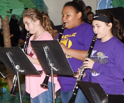 From left, CMS sixth-graders Harley Couch-Allen, Dezarae Washington and C.J. Derringer play clarinet.