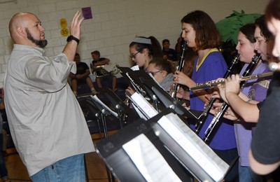 CMS and CHS band director Zach Shelton directs as his students play.