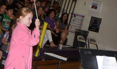 CES third-grader Chloe Bush directs the CMS/CHS band.