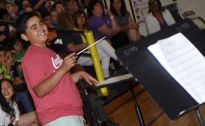 CES fifth-grader Cody Tamez directs the CMS/CHS band.