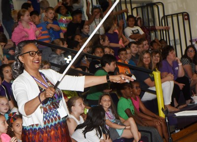 After the band wasn't able to play for her the first time, CES Assistant Principal Doretha Sanders uses a much larger baton so they can keep the beat.
