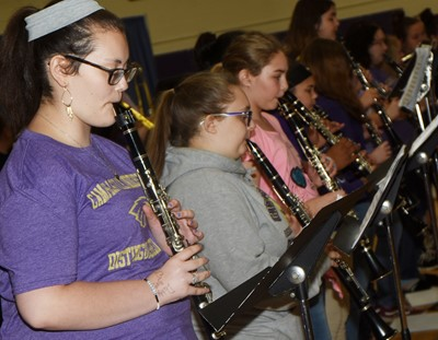 CMS seventh-grader Jasper Wright and her bandmates play clarinet.