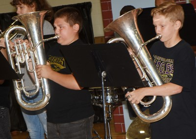 CMS sixth-graders Logan England, at left, and Austin Gabbert play baritone.