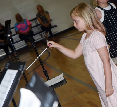 CES first-grader Remi Petett directs the CMS/CHS band.