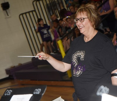 CES teacher Lynne Horn directs the CMS/CHS band.