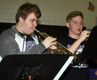 CHS juniors Nathan Anderson, at left, and Tristin Lopez play trumpet.