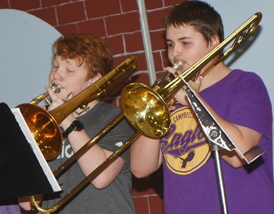 CMS seventh-grader Conner Rinehart, at left, and CHS freshman Kaine Terry play trombone.