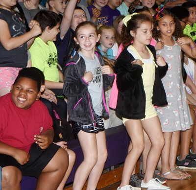 CES students dance as the band plays the Chicken Dance.