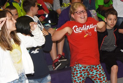 CES fourth-grader Lily Coots dances as the band plays the Chicken Dance.