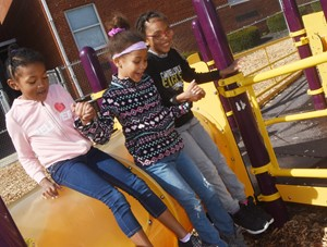 From left, CES first-graders Priyanka Flores, Zaylin Johnson and Daya Griffin play together on the playground.
