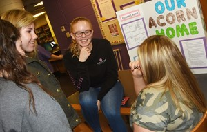 CHS seniors Tahler Franklin, at left, and Aleah Knifley discuss their post-apocalyptic community project.